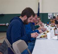 Men_eating_steak_meal